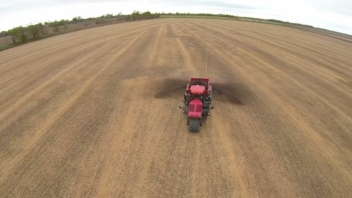 Tractor Spreading Plant Tuff® in Farm Field